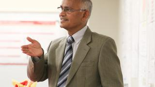 Associate Dean for Research for the College of Engineering Arun Somani speaking during the dedication ceremony