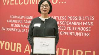 Systems analyst Insook Wessels with her CYtation Award
