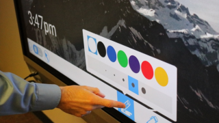 Audiovisual Experience Team Manager Mike Pedersen working on a Newline 86-inch multi-touch display